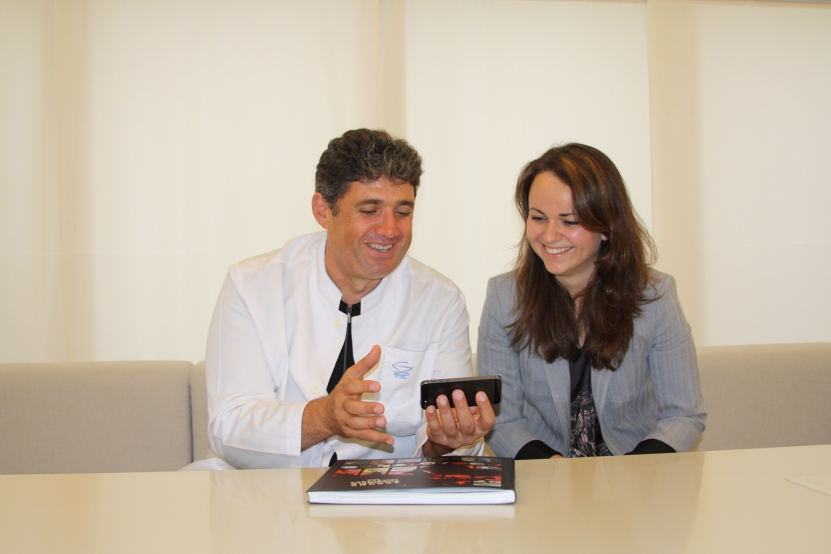 Tamaz showing Katerina Rogova the pictures of new project
