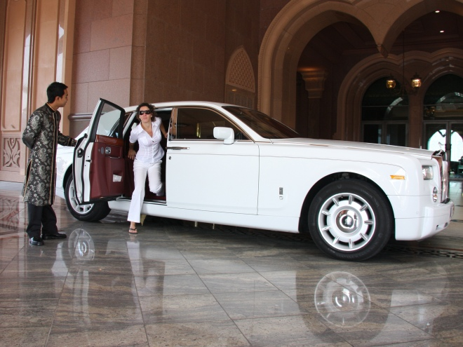 """We touch down at Abu Dhabi Airport in the late afternoon. Our driver is waiting to take us to the Emirates Palace Hotel in a white Rolls Royce."""